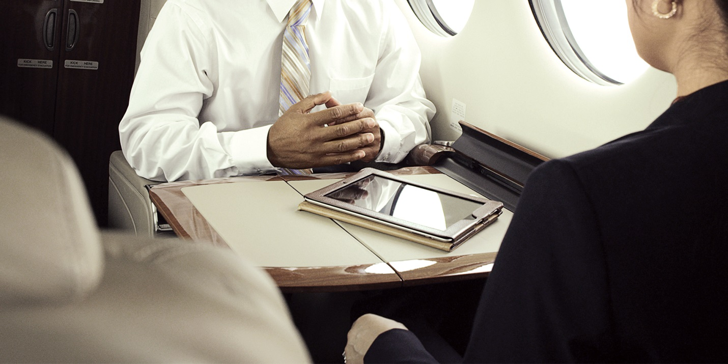 Business meeting in an aircraft