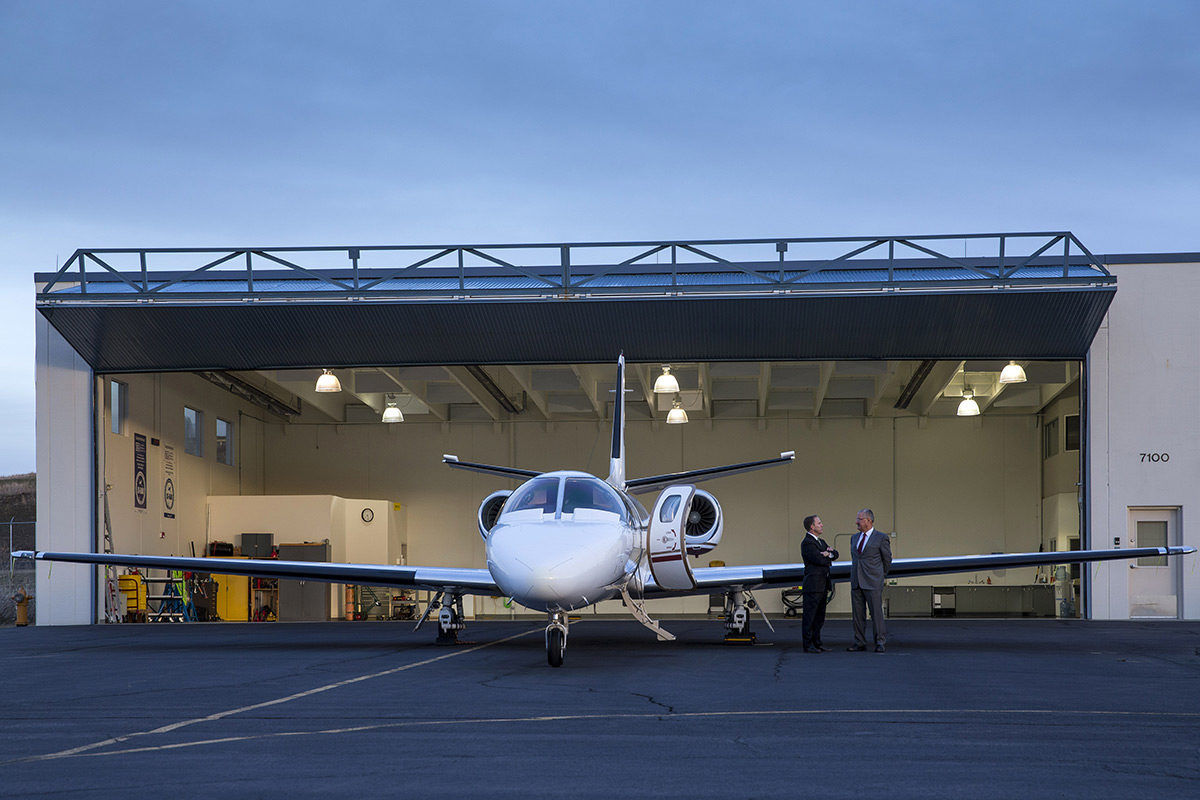 Citation private jet outside hangar