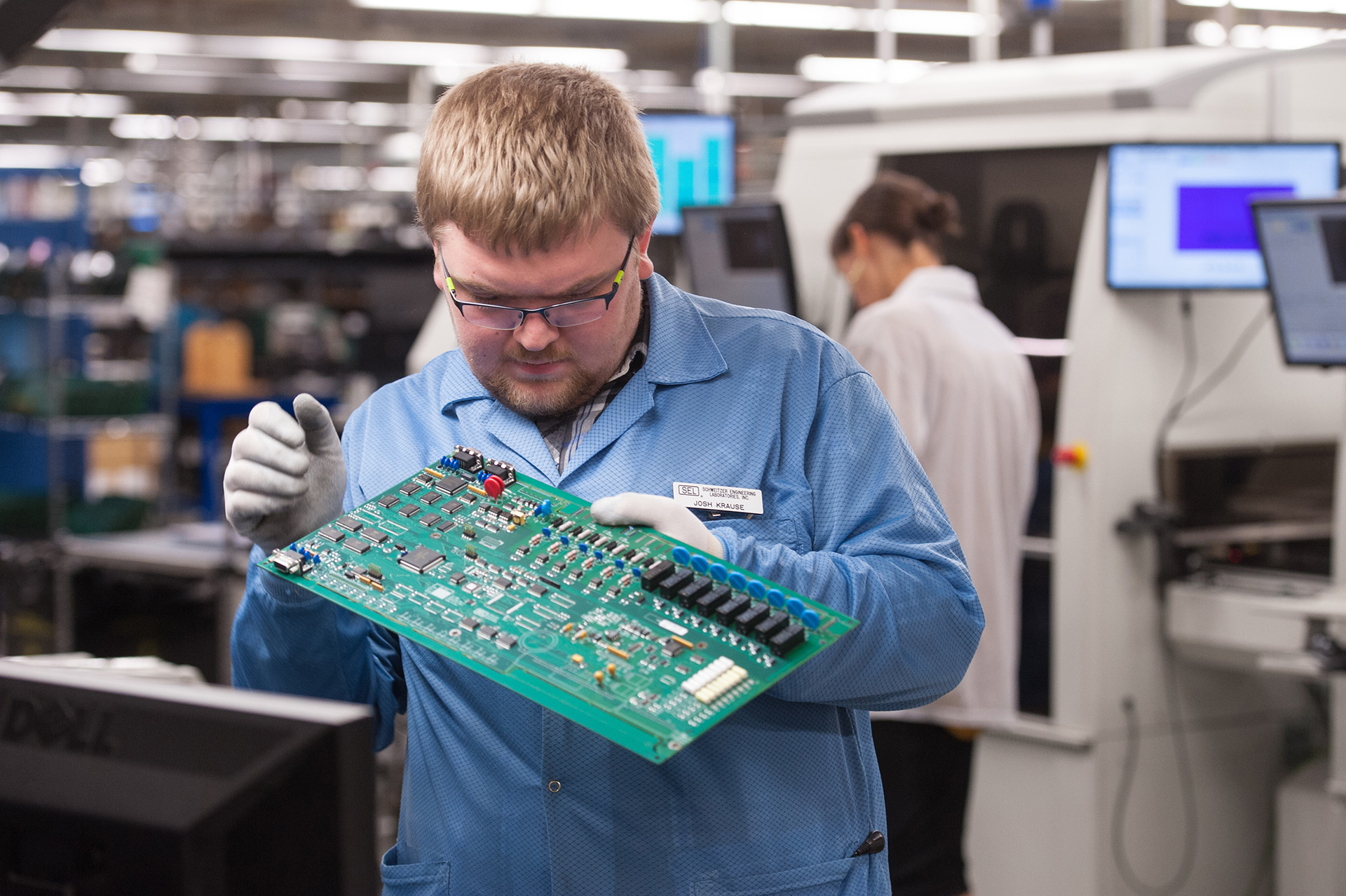 Technician inspects circuit board