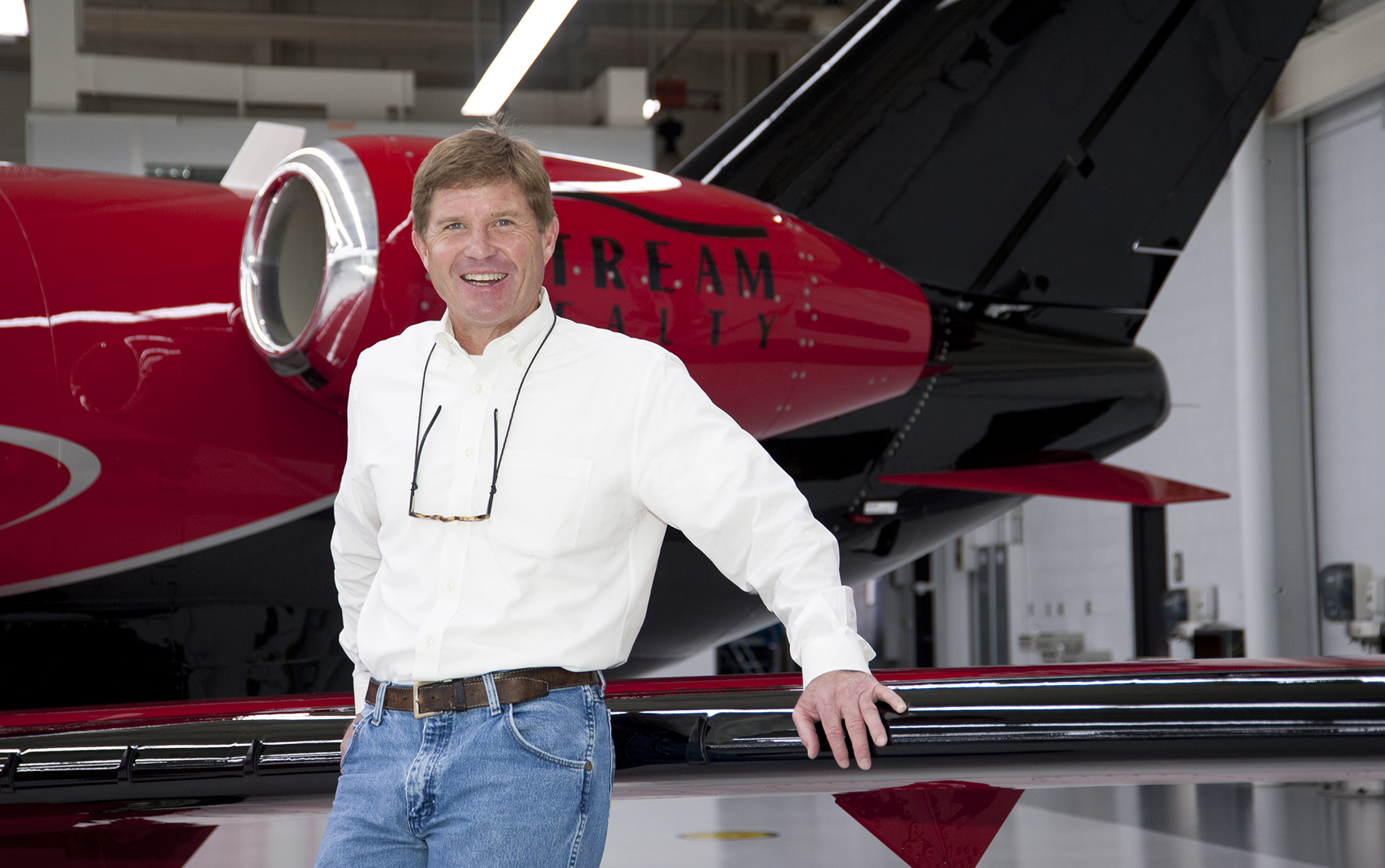 Mike McVean standing in front of his Citation Mustang