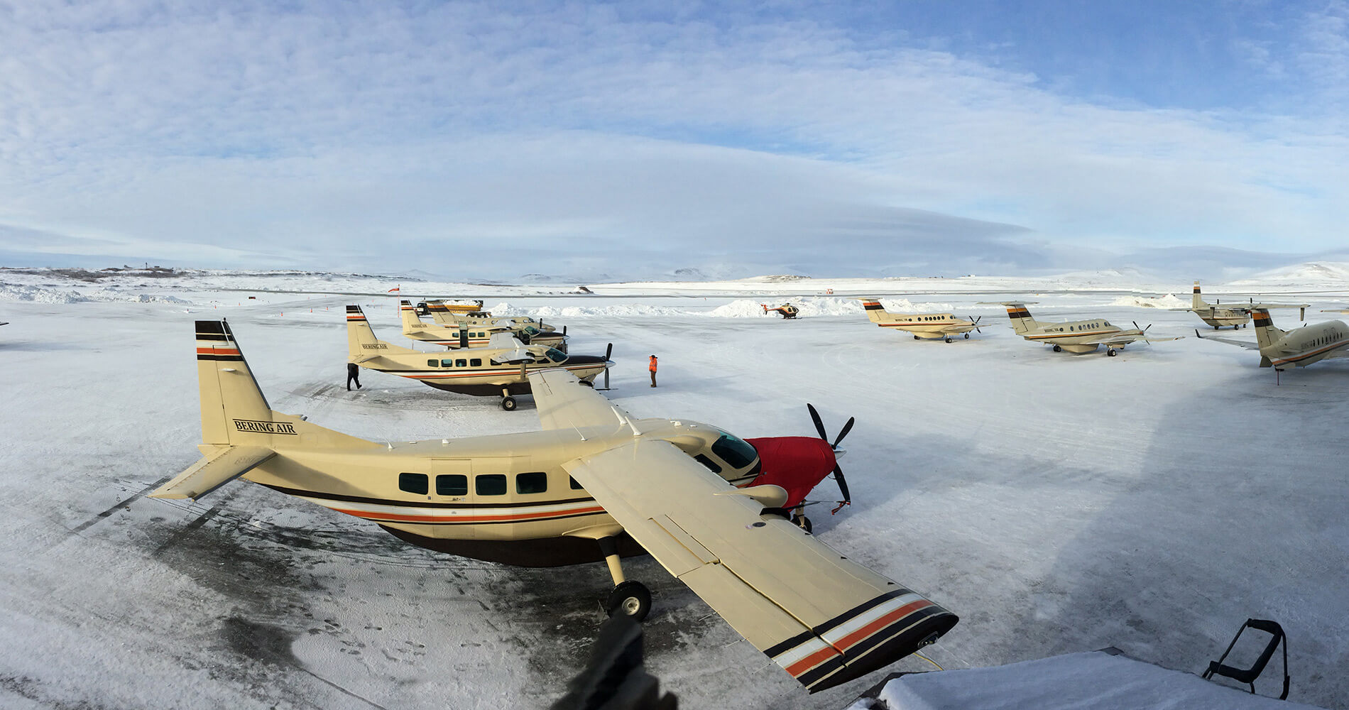 Rows of Cessna Caravans on a snowy ramp