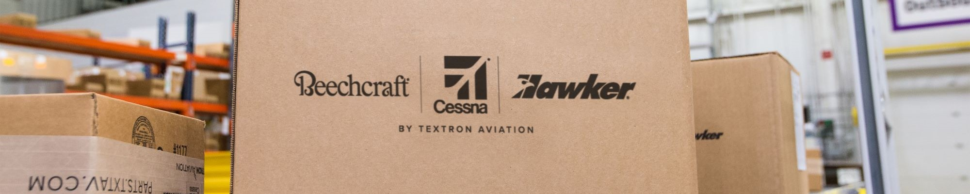 Cessna, Beechcraft and Hawker shipping box on conveyor belt. Shipping status now available in your Textron Aviation account.
